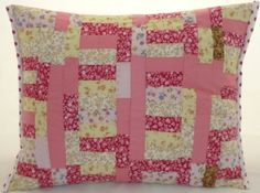 Pink floral and polka dot patchwork cushion