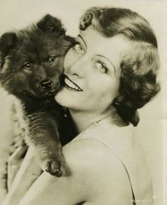 Joan Crawford And Chow Puppy.