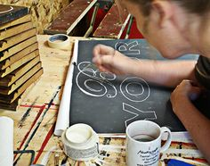 How to Hand paint letters ~ Best tutorial on how to make distressed wood signs. This woman sells her work.