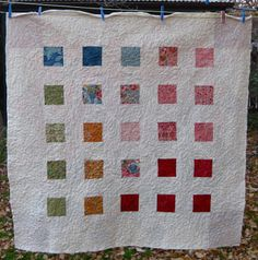 Sizing Finished quilt size is 56 x 56 inches. Quilt top and back Materials 3 charm packs with 42 x 5 inch squares each in total for front and back. The front uses 100 charm squares. I used Moda Bou...