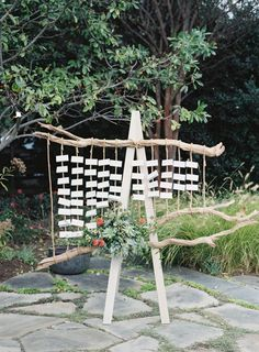 Rustic wood escort card display: http://www.stylemepretty.com/2016/04/07/intimate-outdoor-wedding-filled-with-cultural-meaning/ | Photography: Judy Pak - http://www.judypak.com/