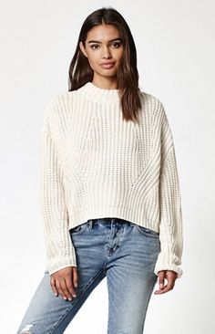 Fall in love with a cozy, chunky knit sweater from Kendall & Kylie. This mock neck sweater features cocoon sleeves, ribbed trim and novelty notches at the sides. Match it with our jeggings and booties for a fun play on proportions.   Mock neck Cocoon sleeves Ribbed trim; Chunky knit         Small side vents Model is wearing a small Model's measurements: Height: 5'8.5'' Bust: 32'' Waist: 24'' Hips: 35''         100% acrylic     ...