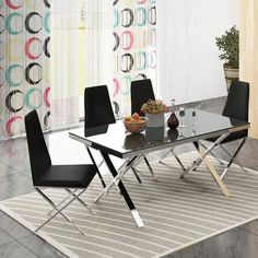 Zara Black Glass Top #DiningTable with Chrome Base comes with a Black Tempered Glass Top. It's extremely stunning design and superb look makes it a perfect deal for your modern #home.