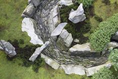 """""""Inspired by he karesansui or dry-landscape style of garden, where the image of a landscape and water is created without the use of actual water, designer Marc Peter Keane used a simple palette of green moss and gray stones o create the effect of a river,"""" writes Lindsey Taylor. See more at Designer Visit: A Gray and Green Garden at Tiger Glen. Photograph by Don Freeman."""