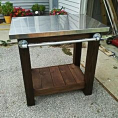 DIY grill table with stainless steel top.