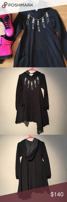 """NWOT Wildfox Skelley Necklace Angel Hoodie This hoodie/dress was shipped without tags. It's never been worn. Color is clean black. Faded black look to it. White skeleton necklace printed on front. Can be worn as a long hoodie or short dress. One slit pocket in front. Flowy, asymmetrical raw hemline. Very soft. Cuffed sleeves. Approximately 14 1/2"""" across the bust when laid flat. Approximately 28"""" at shortest length and 41"""" at longest length. 70% cotton, 30% polyester. Sold out. ❗️Price Is…"""