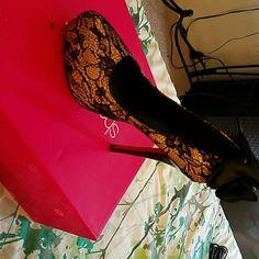 A pair of black lace shoes Lace withe creme Shoe Dazzle Shoes Heels