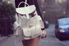 white and gold backpack