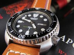 """NEW DC VINTAGE WATCHES AUCTION: Vintage 1981 Seiko 6309-7040 """"Turtle"""" Automatic Diver, w/C&B Leather Strap---The 6309 series of divers is the third generation of Seiko's professional/recreational diving watches – the line replaced the 6105 in 1976 and was produced by Seiko until 1988, when it was replaced by the 7002 model."""