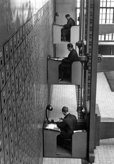 Elevator desks in Prague, 1937 (if only we had scanning and computers back then). These desks were real. The Central Social Institution in Prague was home to the world's largest vertical file cabinet, with over 3,000 drawers. The desks could move up, down, left and right at the push of a button.