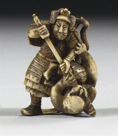 An ivory netsuke - Century. Depicting the general Kato no Kiyomasa dressed in full armour killing a savage man-eating tiger with his spear, signed on an oval reserve Shigechika. Japanese Folklore, Japanese Art, Edo Era, Japanese Characters, Kato, Asian Art, Art Forms, 19th Century, Oriental