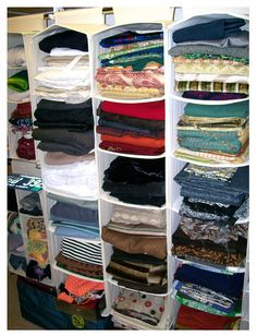 repurposed sweater storage used for fabric in a craft room