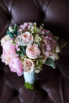 Pale pink and cream Keira #weddingroses make a sweet, chic addition to this #fairytalewedding's #bridalbouquet. The 100 ruffled petals add a small touch of texture amongst the dusty miller and green foliage.   Order them online @ www.parfumflowercompany.com