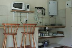 """July se huis""  Sleep 4 people with all four single beds in the main room. The  bathroom has a shower, basin and toilet. The kitchenette comes with a fridge, microwave, kettle, electric frying pan, toaster, necessary cutlery and crockery, braai grid, braai thongs & dish cloths. We also supply starter quantities of dishwash liquid, t-paper, coffee, tea, sugar and milk. Indoor and outdoor braai facilities are available and a private deck. Wood is on sale. Electric Frying Pan, Shower Basin, New Modern House, Single Beds, Self Catering Cottages, Have A Shower, Kitchenette, Thongs, Toaster"