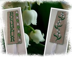 "Lily of the Valley cross stitch instructions, in french.  Click on ""Voir le Fichier : Muguet.pdf couleurs""   for the graph."
