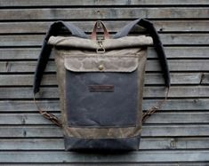 Waxed canvas rucksack/backpack with roll up top от treesizeverse