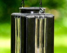 Vintage glass light cover repurposed into candle holder