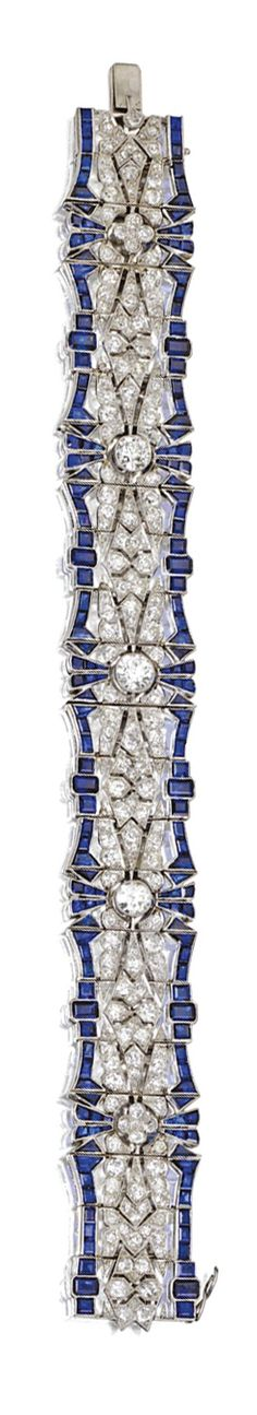 SAPPHIRE AND DIAMOND BRACELET, CIRCA 1925/ The flexible openwork strap set with 3 old European-cut diamonds weighing approximately 1.95 carats, further set with numerous old European-cut and single-cut diamonds weighing approximately 7.95 carats, bordered by numerous calibré-cut sapphires, mounted in platinum
