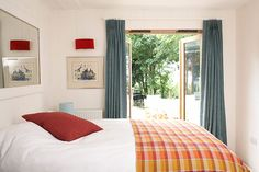 Credit: PR The Blue House, Gunard Several rooms have glass doors that open on to a wraparound terrace, leading to a la...