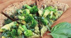 """Paleo, gluten-free pizza recipes are hard to come by, especially ones that don't taste like cardboard. This 5-ingredient, gluten-free crust crisps up like no other cauliflower crust you've ever had, and is topped with a vegan, cashew basil """"cheese,"""" avocado and assorted power-green vegetables."""