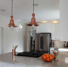 A quick coat of spray paint makes the shades look like vintage copper. See more at Kojo Designs »