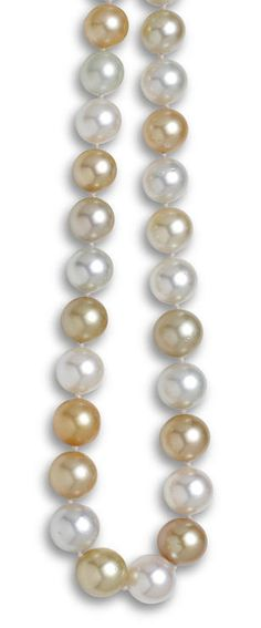 A multi-colored South Sea cultured pearl necklace comprising sixty-one off-round cultured pearls in hues ranging from white to golden-colored, measuring approximately 14.6 to 11.5mm., completed by a pavé-set diamond ball clasp; clasp mounted in eighteen karat gold