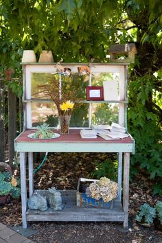 great repurposing a table and window as a potting table or prep table. Love the little 'sink' attached as well.