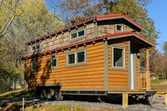 This is a new 10′ x 24′ tiny house by Wishbone Tiny Homes. It was a custom design for a local customer. It's build on a stout 3 axle trailer. It features: A removable front porch over tongue Lapped cedar siding on the bottom + Poplar bark siding on top Onduvilla roofing a cook's kitchen …