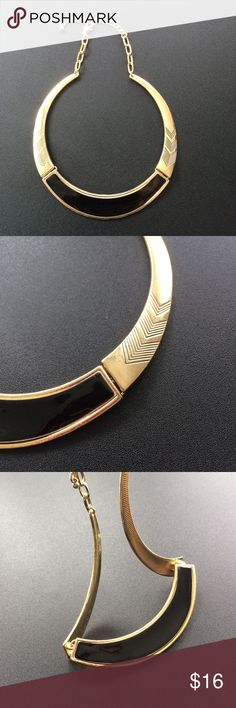 """Gold and black necklace! Stunning gold necklace with black accent on the front and chevron design on the side.  Three pieces attached with two rings.  Just under 5 inches wide. Chain provides multiple lengths. Roughly 6 1/2"""" to 8"""" long. Jewelry Necklaces"""