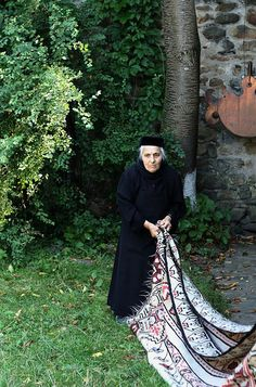 An old nun beating a rug in the garden in a monastery in Romania  ruthdemitroff via Nancy Wuitschick onto Growing older