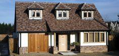 Oak casement windows and oak front door Kloeber.jpg (688×326)