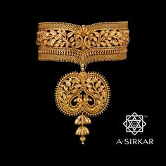 A magnificent peacock choker with a detachable pendant from the house of A.Sirkar Jewellers.