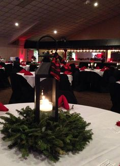 a corporate christmas party color theme traditional christmas red with black accents black lanterns