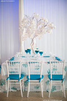Turquoise and White Wedding Table Decor / J Morgan Flowers / Jamilah Photography / via StyleUnveiled.com