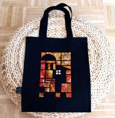 handmade tote bag, black fabric, orange stamp #bag #black #orange #red #yellow #house #architecture #cotton #canvas #shopper #pouch #home #art $20.00