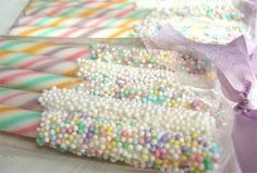 Candy sticks dipped in chocolate then sprinkles. Easy party favor.