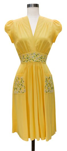 The newest Trashy Diva Daisy Mae Dress in Yellow Rayon features embroidered daisies on the pockets and waistband.