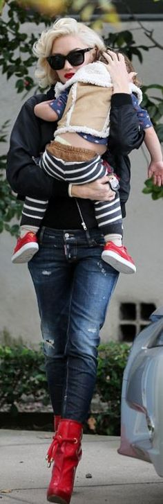 Who made Gwen Stefani's black satin jacket, blue jeans and red patent boots?