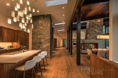 This home stretches across a rocky site with panoramic views of the Carson Range to the east. A retreat family room is situated near the most prominent rock outcropping on the south end of the site, and sits up in the air just off the outcropping like a tree house, and connects to the home by one of the namesake bridges enclosed in glass. The other bridge is a wooden structure linking the Main Terrace to the Master Bedroom Terrace and Spa Area. The unique stone and concrete fireplace…