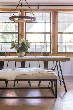 Gorgeous wood and metal dining table with metal chairs and bench farm table hydrangea pine window frames left natural