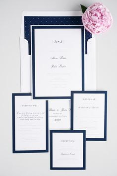 Elegant, sophisticated, and modern navy blue wedding invitations with polka dot envelope liner, borders, and contemporary monogram!