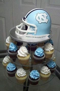 UNC Football helmet cake – fondant covered and decorated.