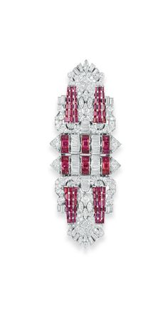 AN ART DECO DIAMOND AND RUBY DOUBLE-CLIP BROOCH  - Each of openwork geometric design, centering upon two baguette-cut diamond and square-cut ruby columns with circular-cut diamond terminals, extending tapered vari-cut diamond openwork plaques, enhanced by bands of calibré-cut rubies, mounted in platinum and white gold, circa 1925. | Christie's