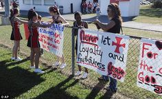 Last stand: The cheerleaders of Kountze Middle School use their faith-based signs at the junior game in a show of defiance