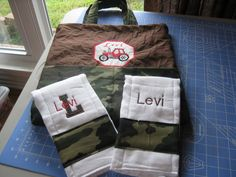This green camo Diaper bag/burp cloths were made for little Levi... with his name and tractor embroidery added...