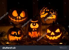 Photo Composition From Five Pumpkins On Halloween. Jack, Terrible Hands, Embittered, A Cyclops And Evil Pumpkin Against An Old Window, Leaves And Candles. - 330447998 : Shutterstock