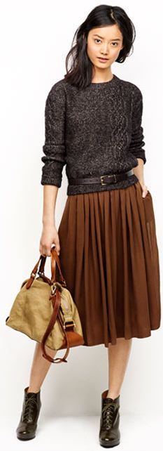Love this looks. Pleated skirt with a sweater that looks like a sweatshirt