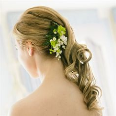 Sideswept Hairstyle with Fresh Flowers…maybe not the flowers