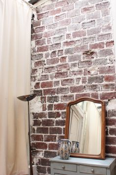 I love the washed brick wall...gives the room character.