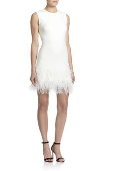 Brides.com: 44 Little White Dresses You Can Buy Right Now Cotton-blend bouclé mini dress, $850, Moschino Cheap & Chic available at  Net-a-PorterPhoto: Courtesy of Net-a-Porter